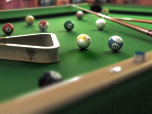 Как выбрать стол для игры в бильярд