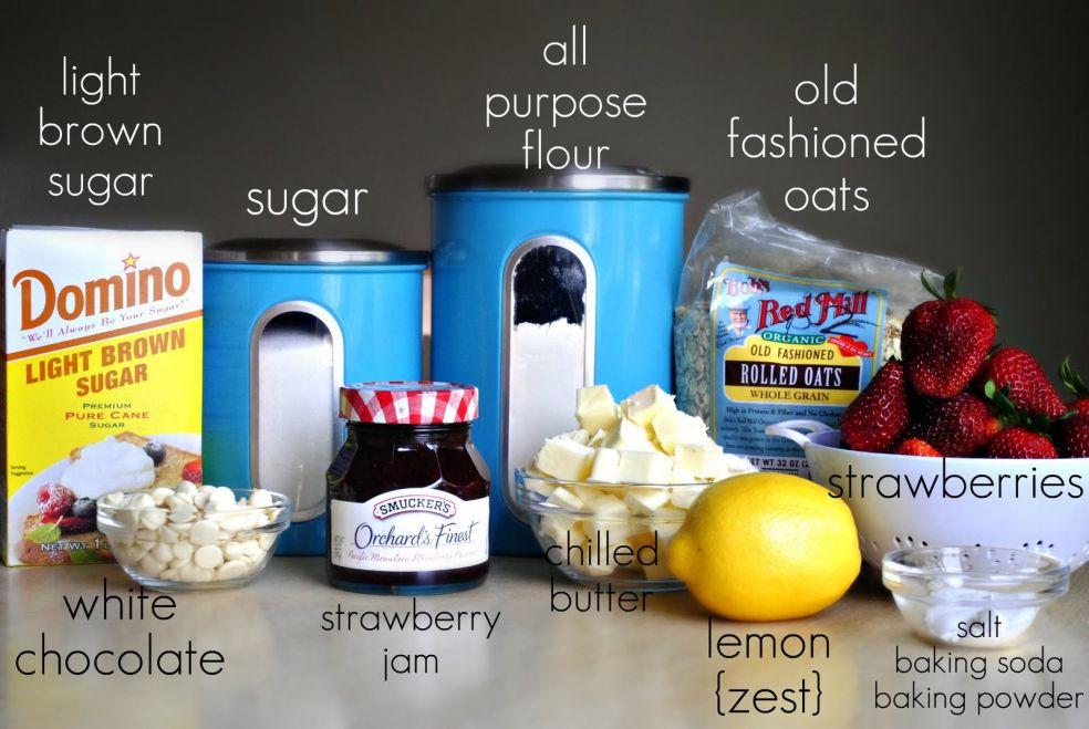 Вам понадобится мука, темный и белый сахар, овсяные хлопья, клубника и клубничный джем, цедра лимона, соль, пекарский порошок, сливочное масло и белый шоколад
